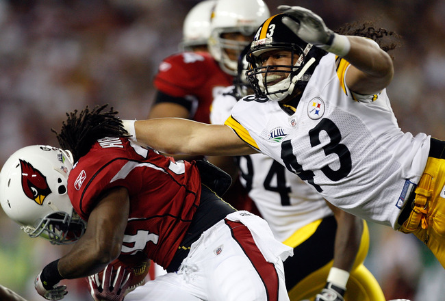 TAMPA, FL - FEBRUARY 01:  Troy Polamalu #43 of the Pittsburgh Steelers attempts to tackle Tim Hightower #34 of the Arizona Cardinals during the first quarter of Super Bowl XLIII on February 1, 2009 at Raymond James Stadium in Tampa, Florida.  (Photo by St