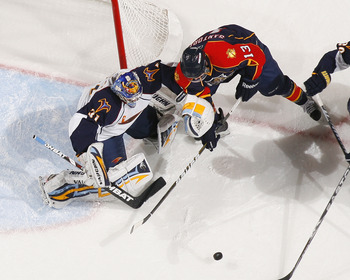 SUNRISE, FL - JANUARY 17: Goaltender Ondrej Pavelec #31 of the Atlanta Thrashers stops a shot by Michael Santorelli #13 of the Florida Panthers on January 17, 2011 at the BankAtlantic Center in Sunrise, Florida. The Thrashers defeated the Panthers 3-2 in