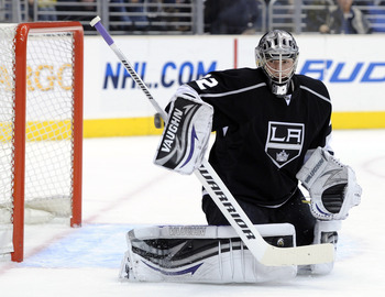 LOS ANGELES, CA - JANUARY 20:  Jonathan Quick #32 of the Los Angeles Kings makes a blocker save off a shot by the Phoenix Coyotes during the first period at the Staples Center on January 20, 2011 in Los Angeles, California.  (Photo by Harry How/Getty Imag
