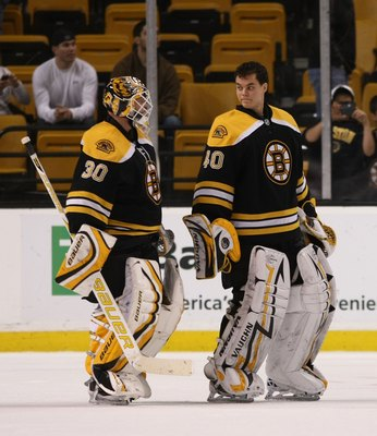 BOSTON - DECEMBER 02: Tim Thomas #30 (L) and Tuukka Rask #40 (R) of the Boston Bruins leaves the ice after their game against the Tampa Bay Lightning at the TD Bank Garden on December 2, 2009 in Boston, Massachusetts. (Photo by Bruce Bennett/Getty Images)