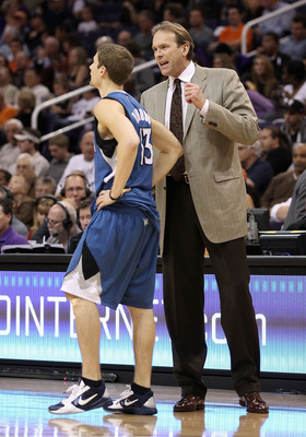 PHOENIX - DECEMBER 15:  Head coach Kurt Rambis  of the Minnesota Timberwolves talks with Luke Ridnour #13 during the NBA game against the Phoenix Suns at US Airways Center on December 15, 2010 in Phoenix, Arizona.  The Suns defeated the Timberwolves 128-1
