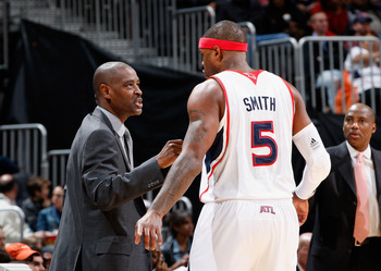 ATLANTA, GA - DECEMBER 11:  Head coach Larry Drew and Josh Smith #5 of the Atlanta Hawks against the Indiana Pacers at Philips Arena on December 11, 2010 in Atlanta, Georgia.  NOTE TO USER: User expressly acknowledges and agrees that, by downloading and/o