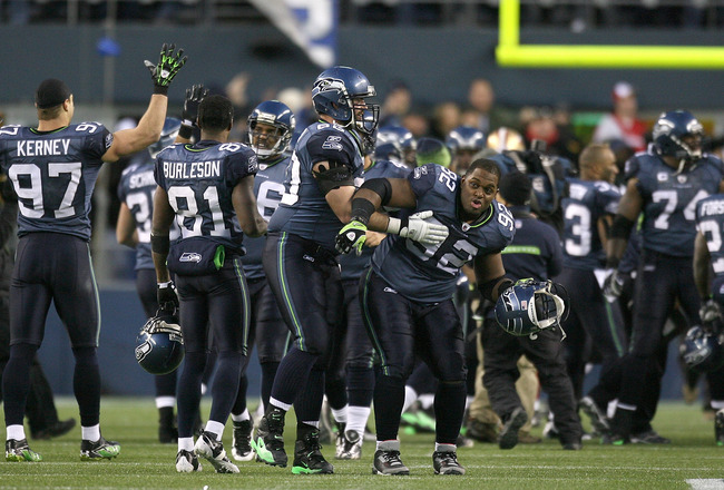 SEATTLE - DECEMBER 06:  Defensive tackle Brandon Mebane #92 of the Seattle Seahawks celebrates with teammates after defeating the San Francisco 49ers 20-17 on December 6, 2009 at Qwest Field in Seattle, Washington. (Photo by Otto Greule Jr/Getty Images)