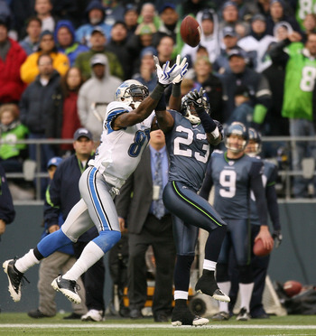 SEATTLE - NOVEMBER 08:  Cornerback Marcus Trufant #23 of the Seattle Seahawks makes an interception against Calvin Johnson #81 of the Detroit Lions on November 8, 2009 at Qwest Field in Seattle, Washington. The Seahawks defeated the Lions 32-20. (Photo by