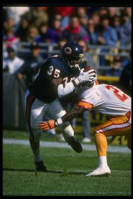 18 Oct 1992: Running back Neal Anderson of the Chicago Bears (left) gets hit by a Tampa Bay Buccaneers player during a game at Soldier Field in Chicago, Illinois. The Bears won the game, 31-14.