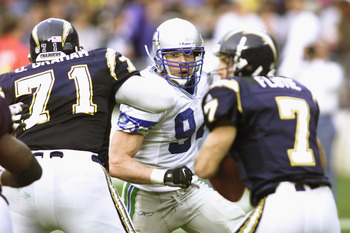 30 Dec 2001:   Chad Brown #94 linebacker for the Seattle Seahawks takes aim at San Diego Chargers quarterback Doug Flutie #7 as Chargers tackle DeMingo Graham #71 blocks at Qualcomm Stadium in San Diego, California. The Seahawks won 25-22. DIGITAL IMAGE