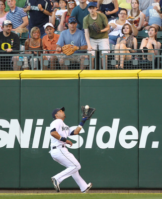 SEATTLE - JULY 08:  Center fielder Franklin Gutierrez #21 of the Seattle Mariners makes a running catch on a fly ball by Curtis Granderson of the New York Yankees at Safeco Field on July 8, 2010 in Seattle, Washington. (Photo by Otto Greule Jr/Getty Image