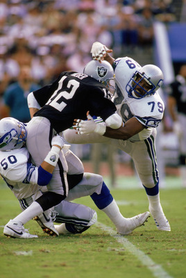 LOS ANGELES - DECEMBER 18:  Defensive end Jacob Green #79 of the Seattle Seahawks tackles a Los Angeles Raiders player on December 18, 1988 in the Los Angeles Coliseum in Los Angeles, California.  The Seahawks won 43-37. (Photo by Rick Stewart/Getty Image