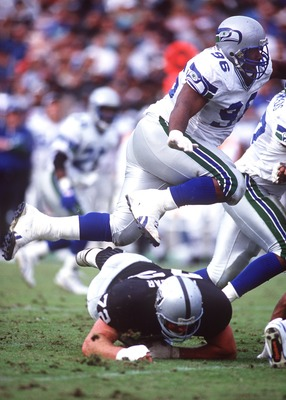 12 Dec 1993: SEATTLE DEFENSIVE TACKLE CORTEZ KENNEDY HURDLES LOS ANGLELES OFFENSIVE LINEMAN DON MOSEBAR DURING THE SEAHAWKS 27-23 LOSS TO THE RAIDERS AT THE LOS ANGELES MEMORIAL COLISEUM.