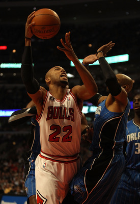 CHICAGO, IL - DECEMBER 01: Taj Gibson #22 of the Chicago Bulls puts up a shot over Vince Carter #15 of the Orlando Magic at the United Center on December 1, 2010 in Chicago, Illinois. NOTE TO USER: User expressly acknowledges and agrees that, by downloadi