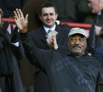BIRMINGHAM, UNITED KINGDOM - FEBRUARY 03:  American football legend and guest of Villa owner Randy Lerner Jim Brown, waves to the crowd before the Barclays Premiership match between Aston Villa and West Ham United at Villa Park on February 3, 2007 in Birm