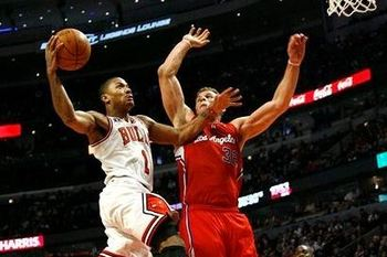 Blake_griffin_tries_to_block_derrick_rose_s_shot_display_image