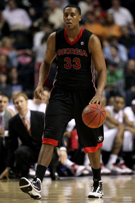 NASHVILLE, TN - MARCH 11:  Trey Thompkins #33 of the Georgia Bulldogs brings the ball up against the Arkanasas Razorbacks during the first round of the SEC Men's Basketball Tournament at the Bridgestone Arena on March 11, 2010 in Nashville, Tennessee.  (P