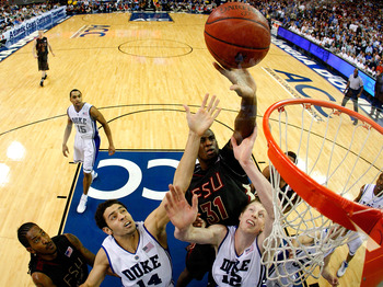 ATLANTA - MARCH 15:  Ryan Reid #42 of the Florida State Seminoles looks on as Chris Singleton #31 tips in a basket against David McClure #14 and Kyle Singler #12 of the Duke Blue Devils during the championship game of the 2009 ACC Men's Basketball Tournam