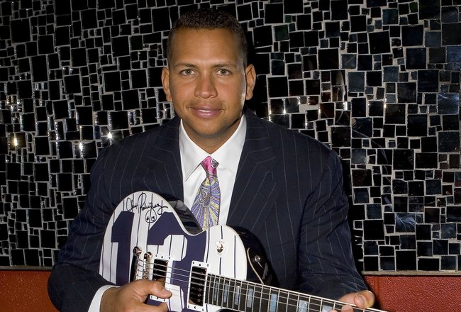 NEW YORK CITY,NY-APRIL 10: New York Yankees third baseman and 2005 American League Most Valuable Player Alex Rodriguez accepts a custom Gibson Guitar at Gotham Magazine's Baseball Party held at Pascha Nightclub. The A-rod custom Gibson Guitar is one of a