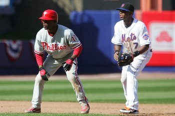 NEW YORK - APRIL 08:  Jimmy Rollins #11 of the Philadelphia Phillies looks to run against Jose Reyes #7 of the New York Mets during the last home opener at Shea Stadium on April 8, 2008 in the Flushing neighborhood of the Queens borough of New York City.