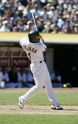 OAKLAND, CA - AUGUST 3:  Shortstop Miguel Tejada #4 of the Oakland Athletics hits a game winning two run double against the New York Yankees during the American League game at the Network Associates Coliseum on August 3, 2003 in Oakland, California.  The