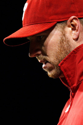PHILADELPHIA - OCTOBER 16:  Roy Halladay #34 of the Philadelphia Phillies looks down against the San Francisco Giants in Game One of the NLCS during the 2010 MLB Playoffs at Citizens Bank Park on October 16, 2010 in Philadelphia, Pennsylvania.  (Photo by
