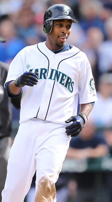 SEATTLE - SEPTEMBER 19:  Chone Figgins #9 of the Seattle Mariners smiles after scoring against catcher Matt Treanor #20 of the Texas Rangers on a double by Franklin Gutierrez #21 in the sixth inning at Safeco Field on September 19, 2010 in Seattle, Washin