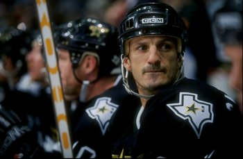 8 Dec 1998:  Center Guy Carbonneau #21 of the Dallas Stars looks on during a game against the Calgary Flames at Canadian Airlines Saddledome in Calgary, Canada. The Stars defeated the Flames 3-2. Mandatory Credit: Ian Tomlinson  /Allsport