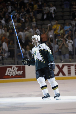 DALLAS - MAY 3:  Derien Hatcher #2 of the Dallas Stars lifts his stick after being named one of the stars of the game against the Mighty Ducks of Anaheim in the 2003 Stanley Cup Western Conference semifinals at the American Airlines Center on May 3, 2003