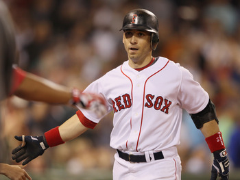 BOSTON - SEPTEMBER 08:  Marco Scutaro #16 of the Boston Red Sox is congratulated after he hit a two run homer against the Tampa Bay Rays on September 8, 2010 at Fenway Park in Boston, Massachusetts.  (Photo by Elsa/Getty Images)