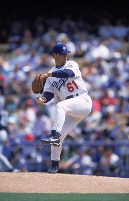 2 Apr 2001:  Pitcher Chan Ho Park #61 of the Los Angeles Dodgers winds up for the pitch during the game against the Milwaukee Brewers at Dodger Stadium in Los Angeles, California.  The Dodgers defeated the Brewers 1-0.Mandatory Credit: Jeff Gross  /Allspo