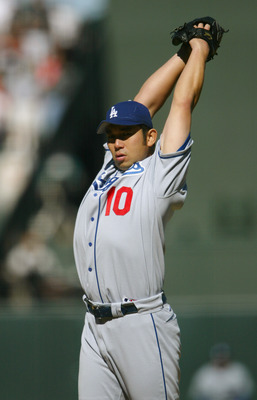 SAN FRANCISCO - JUNE 24:  Hideo Nomo #10 of the Los Angeles Dodgers pitches during the game against the San Francisco Giants on June 24, 2004 at SBC Park in San Francisco, California. The Giants defeated the Dodgers 9-3.  (Photo by Justin Sullivan/Getty I
