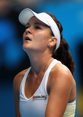 MELBOURNE, AUSTRALIA - JANUARY 26:  Agnieszka Radwanska of Poland reacts to a point in her quarterfinal match against Kim Clijsters of Belgium during day ten of the 2011 Australian Open at Melbourne Park on January 26, 2011 in Melbourne, Australia.  (Phot