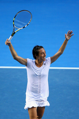 MELBOURNE, AUSTRALIA - JANUARY 23:  Francesca Schiavone of Italy celebrates after winning her fourth round match against Svetlana Kuznetsova of Russia during day seven of the 2011 Australian Open at Melbourne Park on January 23, 2011 in Melbourne, Austral