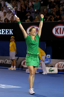 MELBOURNE, AUSTRALIA - JANUARY 29:  Kim Clijsters of Belgium celebrates championship point in her women's final match against Na Li of China during day thirteen of the 2011 Australian Open at Melbourne Park on January 29, 2011 in Melbourne, Australia.  (P