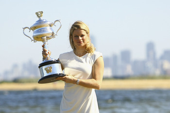 MELBOURNE, AUSTRALIA - JANUARY 30:  Kim Clijsters of Belgium poses with the Daphne Akhurst Trophy after winning the 2011 Women's Australian Open final, at Brighton Beach on January 30, 2011 in Melbourne, Australia.  (Photo by Robert Prezioso/Getty Images)