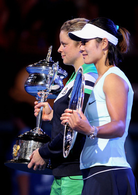 MELBOURNE, AUSTRALIA - JANUARY 29:  Kim Clijsters of Belgium (L) poses with the Daphne Akhurst Trophy after winning her women's final match against Na Li of China, posing with the runner's up trophy, during day thirteen of the 2011 Australian Open at Melb
