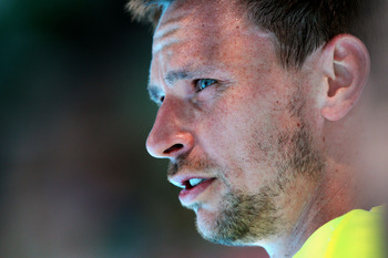 MELBOURNE, AUSTRALIA - JANUARY 24:  Robin Soderling of Sweden looks on in his fourth round match against Alexandr Dolgopolov of the Ukraine during day eight of the 2011 Australian Open at Melbourne Park on January 24, 2011 in Melbourne, Australia.  (Photo