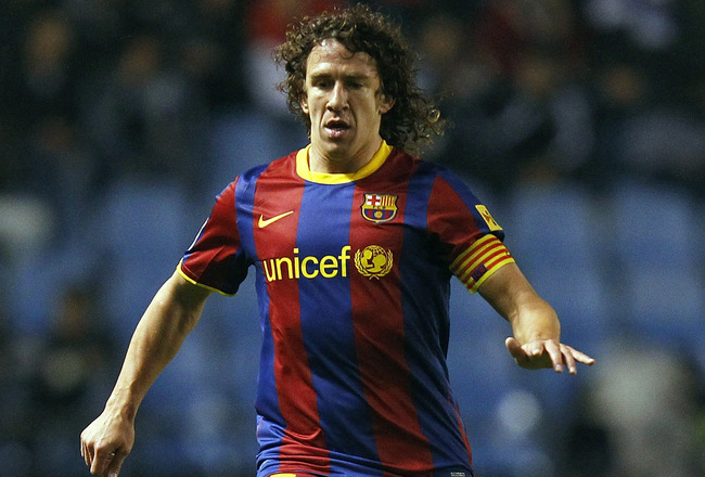 LA CORUNA, SPAIN - JANUARY 08: Carles Puyol of Barcelona in action during the La Liga match between Deportivo La Coruna and Barcelona at Riazor Stadium on January 8, 2011 in La Coruna, Spain.  (Photo by Angel Martinez/Getty Images)