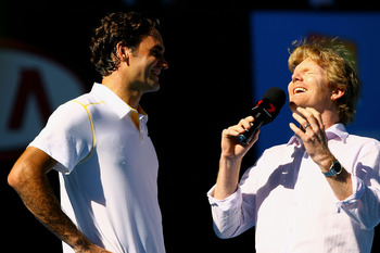 MELBOURNE, AUSTRALIA - JANUARY 23:  Roger Federer of Switzerland is interviewed by Jim Courier after winning his fourth round match against Tommy Robredo of Spain during day seven of the 2011 Australian Open at Melbourne Park on January 23, 2011 in Melbou