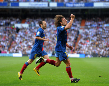 MADRID, SPAIN - MAY 02:  Carles Puyol (R) of Barcelona celebrates scoring his sides second goal during the La Liga match between Real Madrid and Barcelona at the Santiago Bernabeu Stadium on May 2, 2009 in Madrid, Spain. Barcelona won the match 6-2.  (Pho