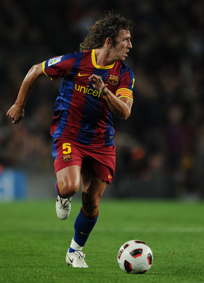 BARCELONA, SPAIN - OCTOBER 16:  Carles Puyol of Barcelona runs with the ball during the La Liga match between Barcelona and Valencia at the Camp Nou stadium on October 16, 2010 in Barcelona, Spain. Barcelona won the match 2-1.  (Photo by Jasper Juinen/Get