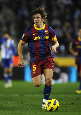 BARCELONA, SPAIN - DECEMBER 18:  Carles Puyol of Barcelona runs with the ball during the La Liga match between Espanyol and Barcelona at Cornella - El Prat stadium on December 18, 2010 in Barcelona, Spain. Barcelona won the match 1-5.  (Photo by David Ram