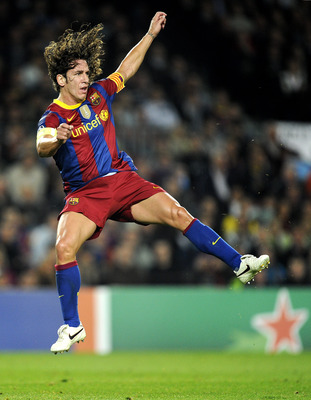 BARCELONA, SPAIN - OCTOBER 20:  Carles Puyol of Barcelona jumps after kicking the ball during the UEFA Champions League group D match between Barcelona and FC Copenhagen at the Camp nou stadium on October 20, 2010 in Barcelona, Spain. Barcelona won the ma