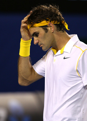 MELBOURNE, AUSTRALIA - JANUARY 27:  Roger Federer of Switzerland reacts in his semifinal match against Novak Djokovic of Serbia during day eleven of the 2011 Australian Open at Melbourne Park on January 27, 2011 in Melbourne, Australia.  (Photo by Mark Da