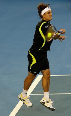 MELBOURNE, AUSTRALIA - JANUARY 28:  David Ferrer of Spain plays a forehand in his semifinal match against Andy Murray of Great Britain during day twelve of the 2011 Australian Open at Melbourne Park on January 28, 2011 in Melbourne, Australia.  (Photo by