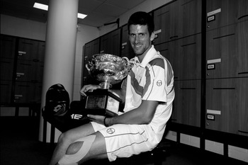 MELBOURNE, AUSTRALIA - JANUARY 30:  (EDITORS NOTE: Image has been converted to black and white.) Novak Djokovic of Serbia poses with the Norman Brookes Challenge Cup in the players locker room after winning the men's final match against Andy Murray of Gre