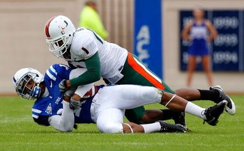 DURHAM, NC - OCTOBER 18:  Receiver Eron Riley #15 of the Duke Blue Devils pulls in this reception against Brandon Harris #1 of the Miami Hurricanes during the game at Wallace Wade Stadium on October 18, 2008 in Durham, North Carolina.  (Photo by Kevin C.