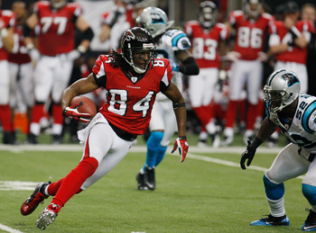 ATLANTA, GA - JANUARY 02:  Roddy White #84 of the Atlanta Falcons runs upfield during the game against the Carolina Panthers at the Georgia Dome on January 2, 2011 in Atlanta, Georgia.  (Photo by Scott Halleran/Getty Images)