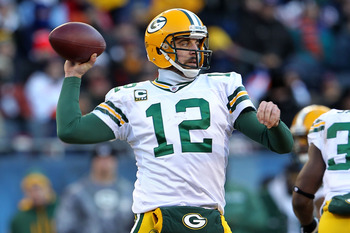 CHICAGO, IL - JANUARY 23:  Quarterback Aaron Rodgers #12 of the Green Bay Packers looks to pass against the Chicago Bears in the NFC Championship Game at Soldier Field on January 23, 2011 in Chicago, Illinois.  (Photo by Jamie Squire/Getty Images)