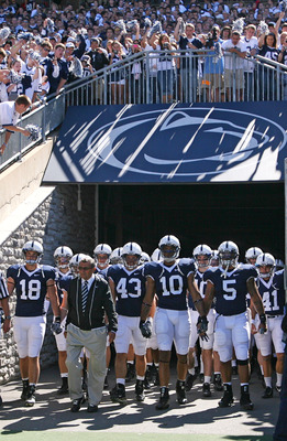 STATE COLLEGE, PA - SEPTEMBER 19: Head coach Joe Paterno of the Penn State Nittany Lions leads his team onto the field before a game against the Temple Owls on September 19, 2009 at Beaver Stadium in State College, Pennsylvania. (Photo by Hunter Martin/Ge
