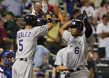 NEW YORK - AUGUST 11:  Melvin Mora #6 of the Colorado Rockies celebrates with teammate Carlos Gonzalez #5 after he hit a grand slam home run in the 8th inning against the New York Mets at Citi Field on August 11, 2010 in the Flushing neighborhood of the Q