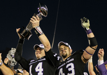 PASADENA, CA - JANUARY 01:  Quarterback Andy Dalton #14 and linebacker Tank Carder #43 of the TCU Horned Frogs celebrate with the Rose Bowl Championship Trophy after defeating the Wisconsin Badgers 21-19 in the 97th Rose Bowl game on January 1, 2011 in Pa