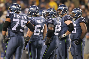 SEATTLE, WA - JANUARY 02:  Members of the Seattle Seahawks offensive line stand on the field during the game against the St. Louis Ramsat Qwest Field on January 2, 2011 in Seattle, Washington.  (Photo by Otto Greule Jr/Getty Images)